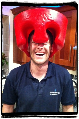 man with bumbo on his head